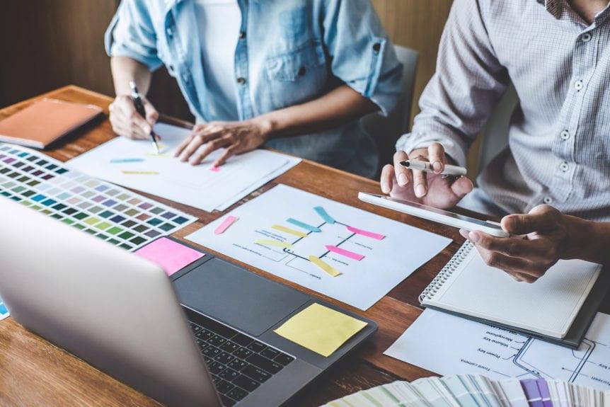 team of web and graphic designers planning UI design